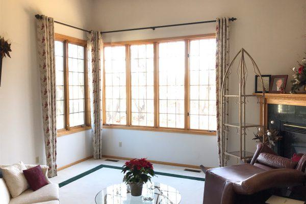 corner window with window curtains
