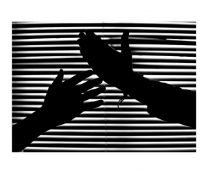 Hands in front of blinds